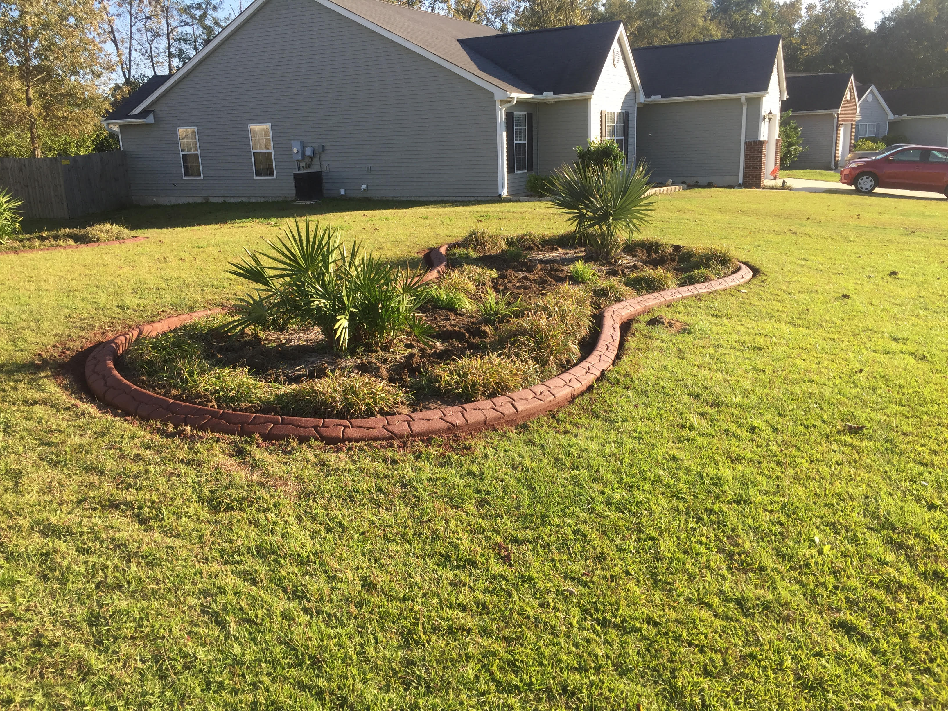 Landscaping curbing concrete borders summerville sc for Creative edge flowers